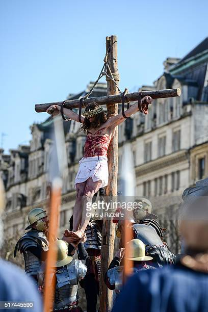 Actor James BurkeDunsmore is lowered from a crucifix whilst playing Jesus during The Wintershall's 'The Passion of Jesus' in front of crowds on Good...