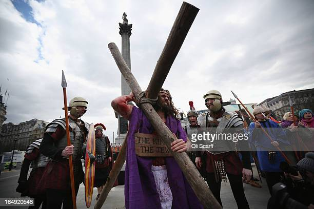 Actor James BurkeDunsmore performs the role of Jesus in 'The Passion of Jesus' on Good Friday to crowds in Trafalgar Square on March 29 2013 in...