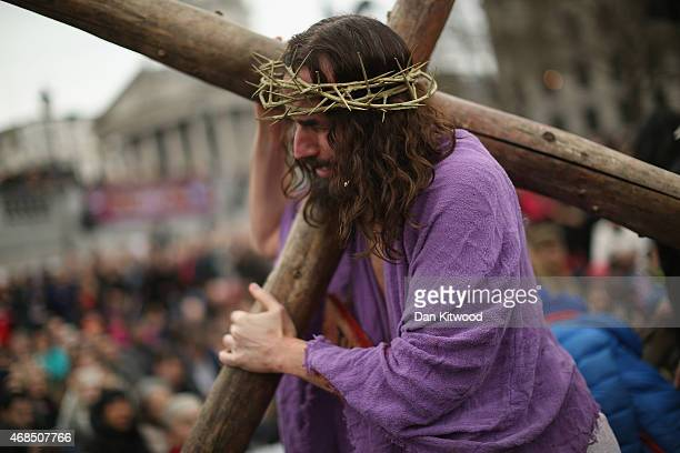 Actor James BurkeDunsmore playing Jesus drags the cross during the Wintershall's 'The Passion of Jesus' production on Good Friday in Trafalgar Square...