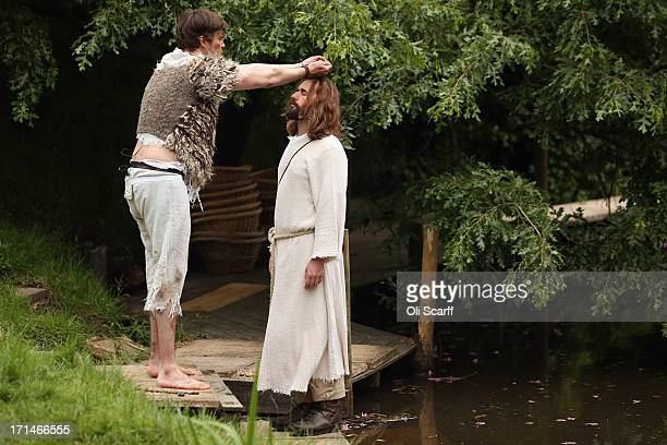 Actor James BurkeDunsmore playing Jesus is baptised by John the Baptist during a rehearsal of the 'Life of Christ' on the Wintershall Estate on June...