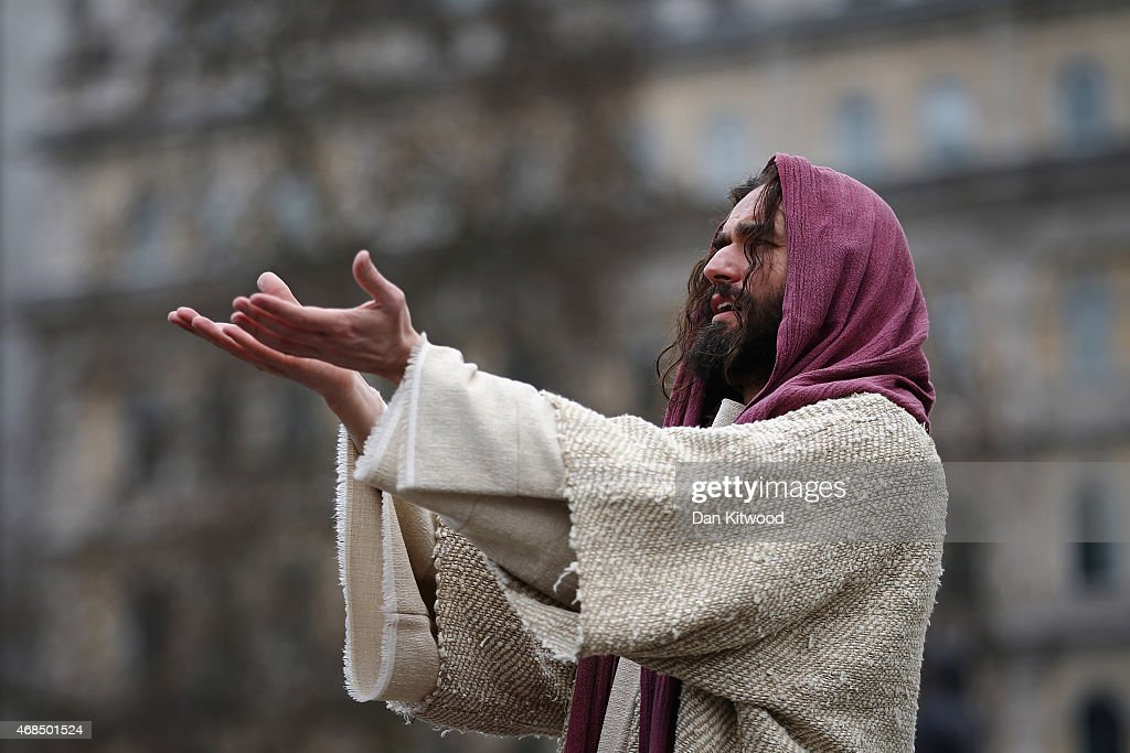 Actor James BurkeDunsmore plays Jesus during The Wintershall's 'The Passion of Jesus' in front of crowds on Good Friday in Trafalgar Square on April...