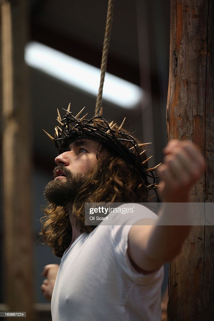 Actor James Burke-Dunsmore plays Jesus in a rehearsal of 'The Passion of Jesus' by the Wintershall Players on the Wintershall estate on March 16, 2013 in Bramley, England. The Wintershall Players are based on the estate and perform several biblical theatrical productions per year. Their performance of 'The Passion of Jesus' will be performed live in Trafalgar Square, London on Good Friday, March 29, 2013. The production includes a cast of 78 actors, horses, a donkey and authentic costumes of Roman soldiers in the 12th Legion of the Roman Army.