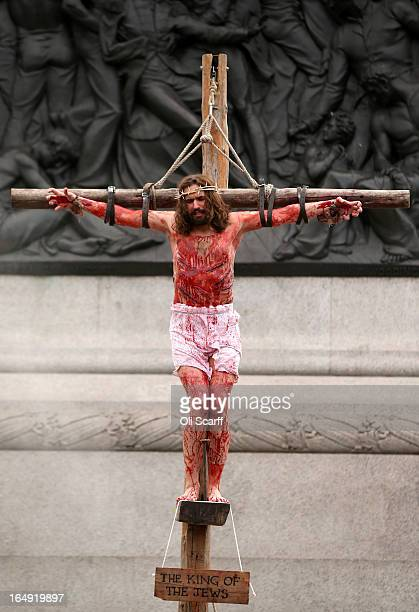 Actor James BurkeDunsmore plays Jesus in 'The Passion of Jesus' on Good Friday to crowds in Trafalgar Square on March 29 2013 in London England The...