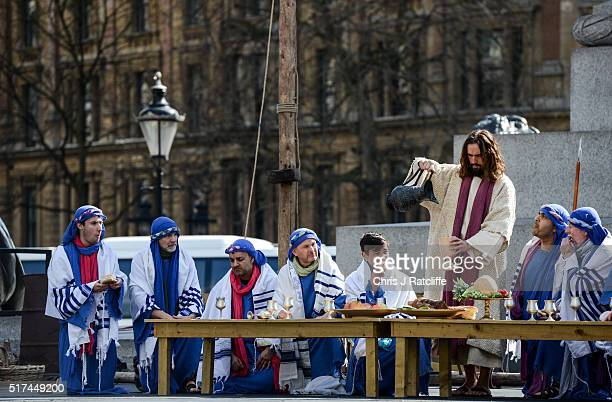 Actor James BurkeDunsmore shares wine with his disciples during the last supper whilst playing Jesus during The Wintershall's 'The Passion of Jesus'...