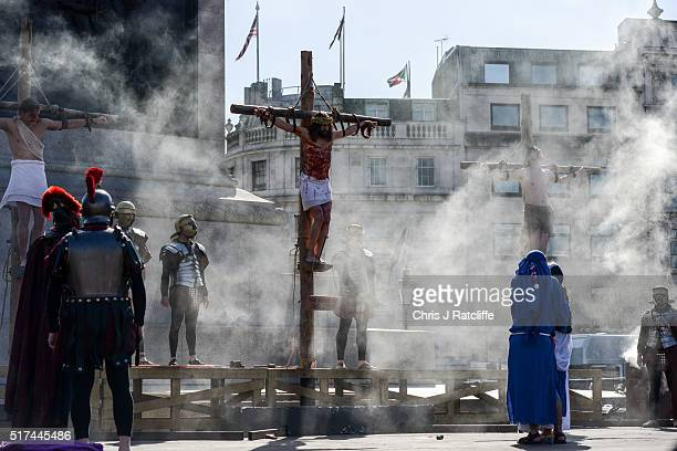Actor James BurkeDunsmore stands on a crucifix whilst playing Jesus during The Wintershall's 'The Passion of Jesus' in front of crowds on Good Friday...