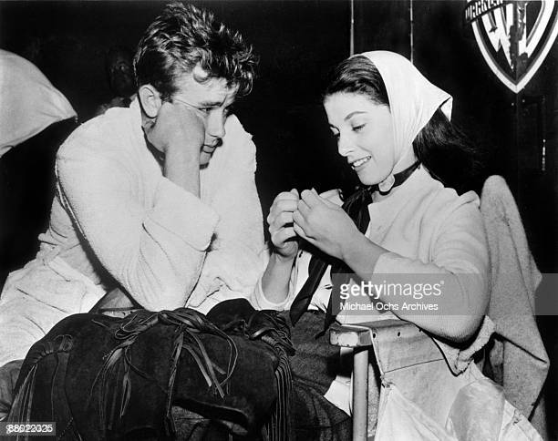 Actor James Dean chats with his girlfriend actress Pier Angeli on the set of the Warner Bros film 'East Of Eden' in 1954 in Los Angeles California