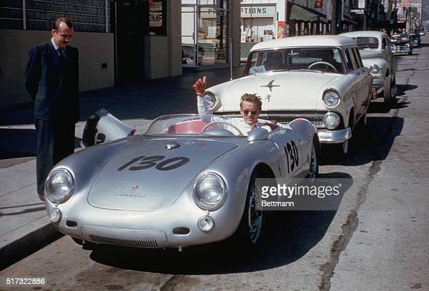Actor James Dean gives a thumbsup sign from his Porsche 550 Spyder the Little Bastard while parked on Vine Street in Hollywood Dean who had taken up...