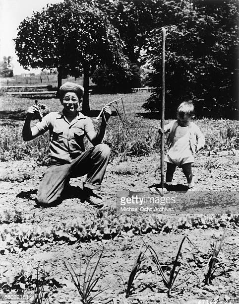 Actor James Dean mugs for the camera with his cousin on his Uncle and Aunt's farm circa 1944 in Fairmount Indiana