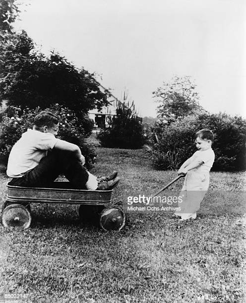 Actor James Dean plays with his cousin on his Uncle and Aunt's farm circa 1945 in Fairmount Indiana