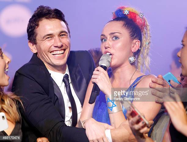 Actor James Franco and musician Miley Cyrus perform onstage during Hilarity for Charity's Annual Variety Show James Franco's Bar Mitzvah benefitting...