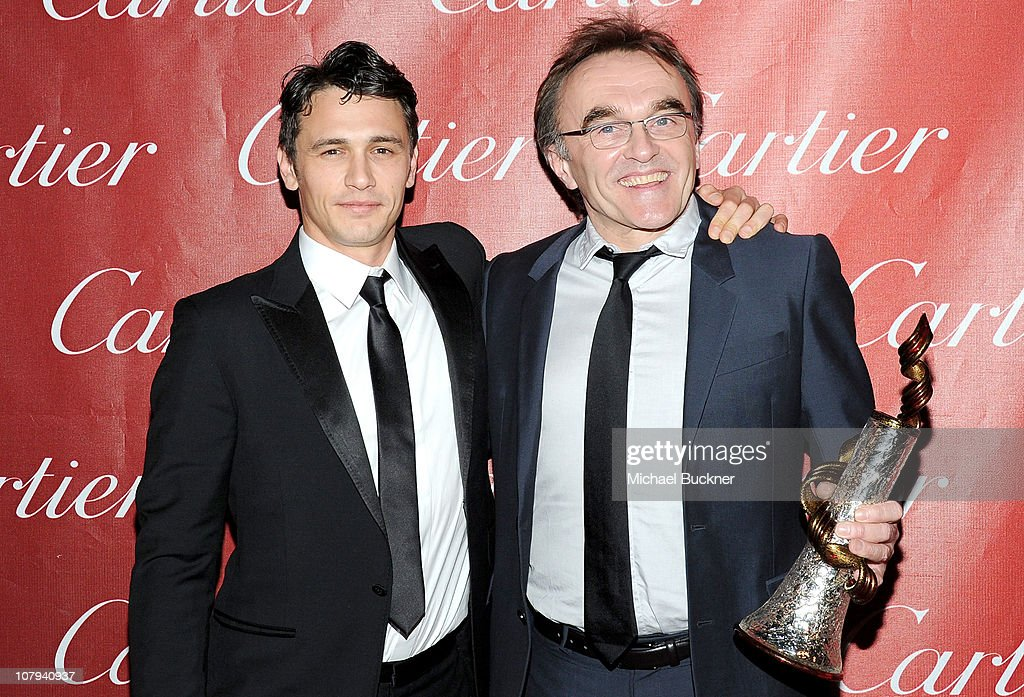 Actor James Franco and Sonny Bono Visionary Award winner Danny Boyle pose backstage at the 22nd Annual Palm Springs International Film Festival Awards Gala at the Palm Springs Convention Center on January 8, 2011 in Palm Springs, California.