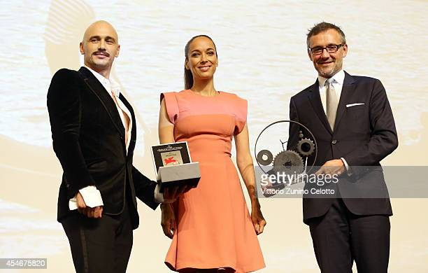 Actor James Franco as he receives the LeCoultre Glory To The Filmmaker 2014 Award with Carmen Chaplin and Laurent Vinay during the 71st Venice Film...