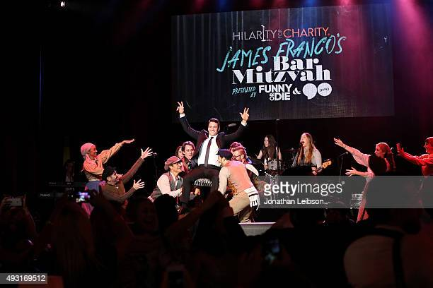Actor James Franco members of the music group HAIM and variety show performers perform onstage during Hilarity for Charity's annual variety show...