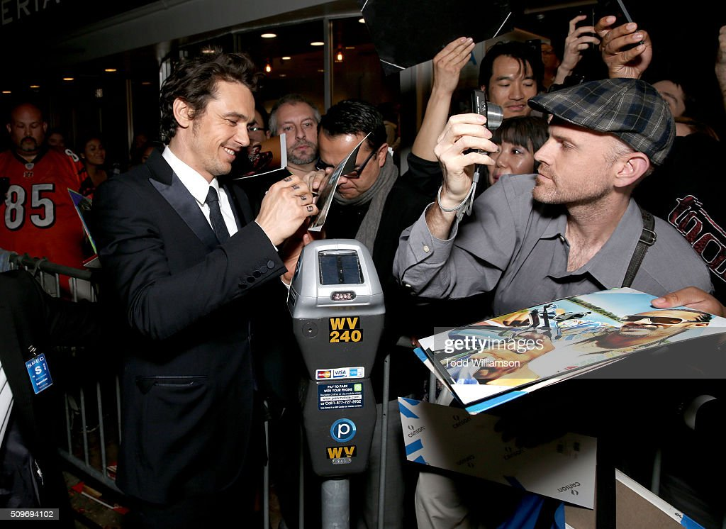 Actor <a gi-track='captionPersonalityLinkClicked' href=/galleries/search?phrase=James+Franco&family=editorial&specificpeople=577480 ng-click='$event.stopPropagation()'>James Franco</a> signs autographs for fans at the Hulu Original '11.22.63' premiere at the Regency Bruin Theatre on February 11, 2016 in Los Angeles, California.