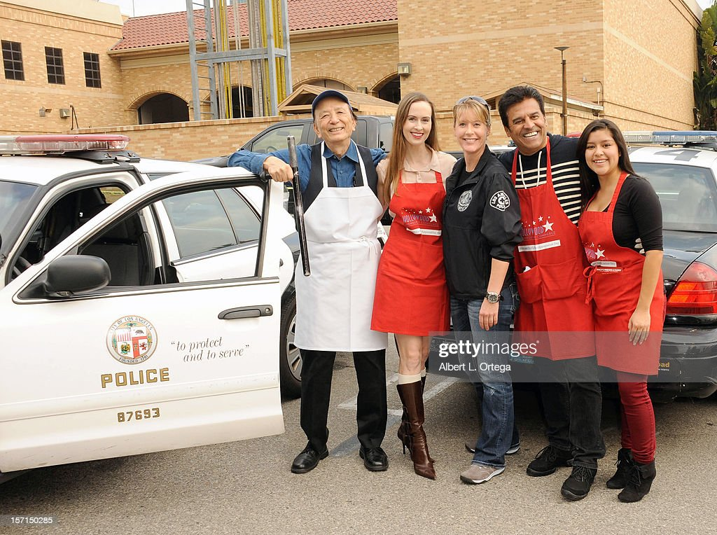 Actor James Hong, actress Erin Carufel, actor Erik Estrada and actress Chelsea Rendon participate in the Hollywood Chamber of Commerce's annual police and firefighters appreciation day at the Hollywood LAPD station on November 28, 2012 in Hollywood, California.