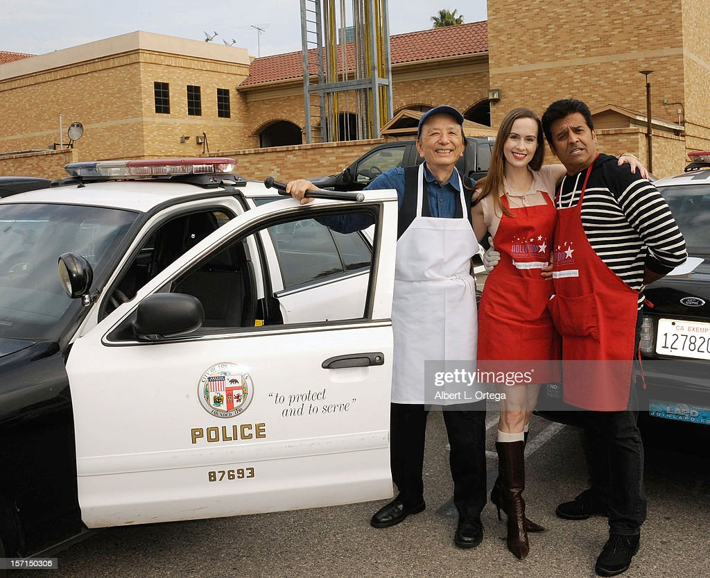 Actor James Hong, actress Erin Carufel and actor Erik Estrada participate in the Hollywood Chamber of Commerce's annual police and firefighters appreciation day at the Hollywood LAPD station on November 28, 2012 in Hollywood, California.