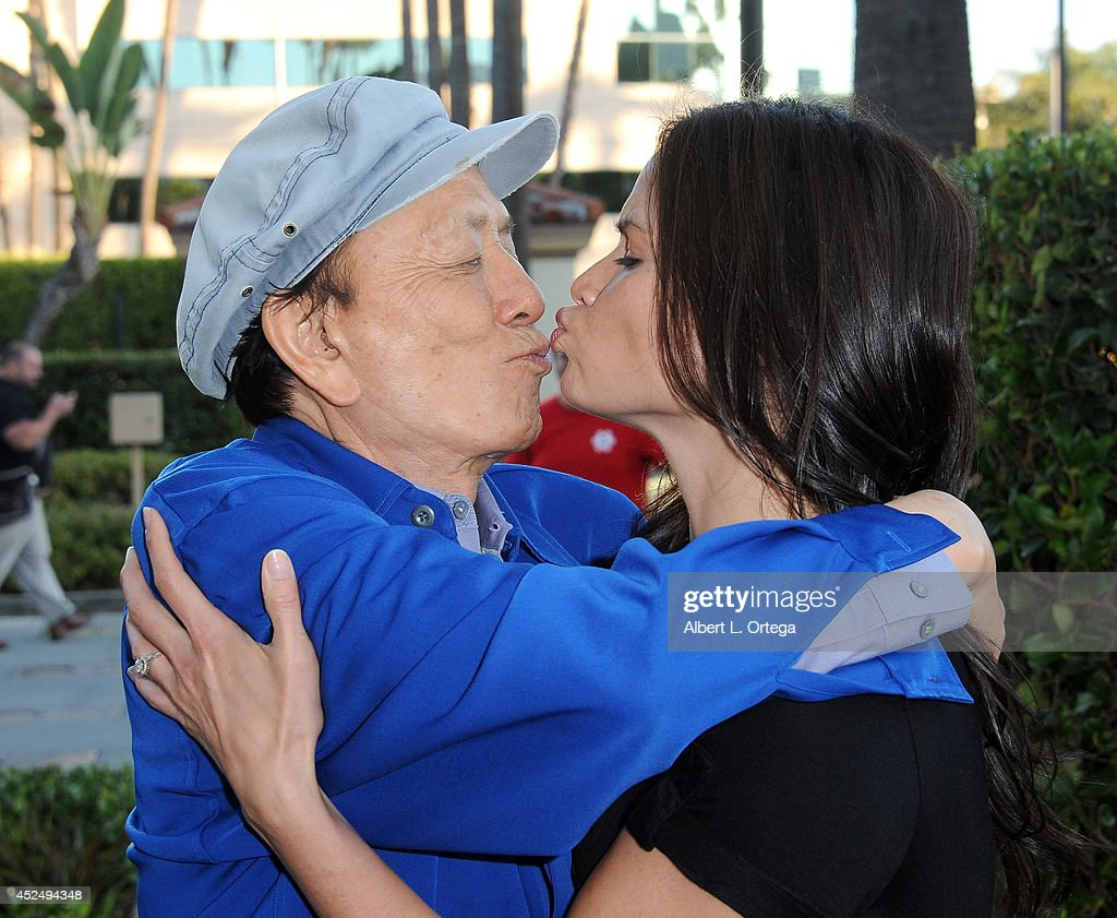 Actor James Hong and actress Katrina Law arrive for the 4th Annual Variety - The Children's Charity Of Southern CA Texas Hold 'Em Poker Tournament held at Paramount Studios on July 16, 2014 in Hollywood, California.