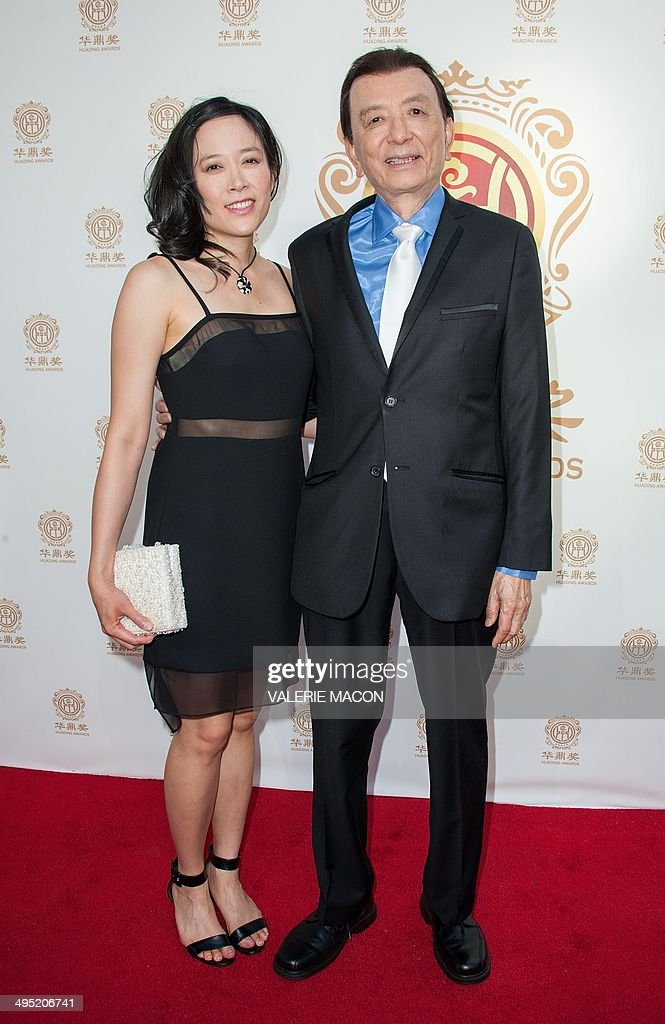 Actor James Hong (R) and daughter April Hong arrive at China's first Film Awards, Huading Film Awards, in Hollywood, California June 1, 2014. AFP PHOTO / Valerie Macon