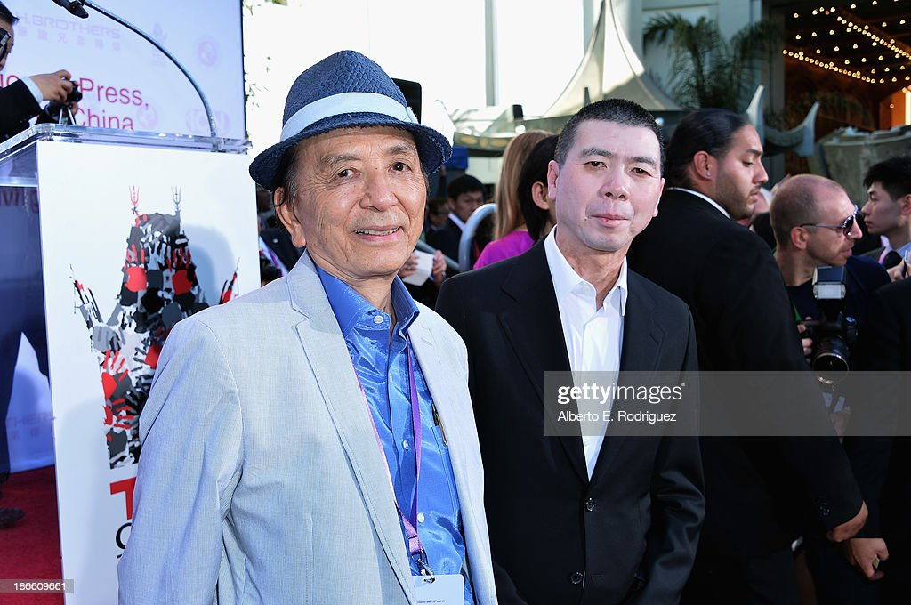 Actor James Hong and director Feng Xiaogang attend a ceremony immortalizing director Feng Xiaogang with a hand and footprint at TCL Chinese Theatre...