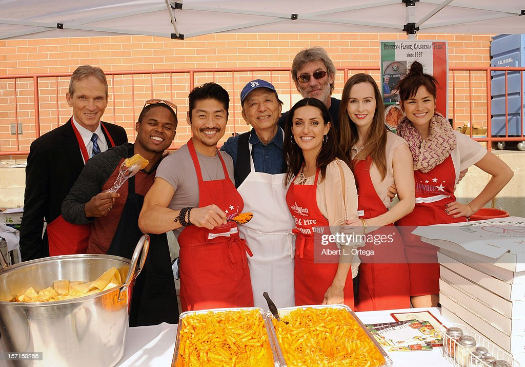 Actor James Horan, actor Walter Jones, actor Brian Tee, actress Mirelly Taylor, actress Erin Carufel and actress Stephanie Danielson participate in the Hollywood Chamber of Commerce's annual police and firefighters appreciation day at the Hollywood LAPD station on November 28, 2012 in Hollywood, California.