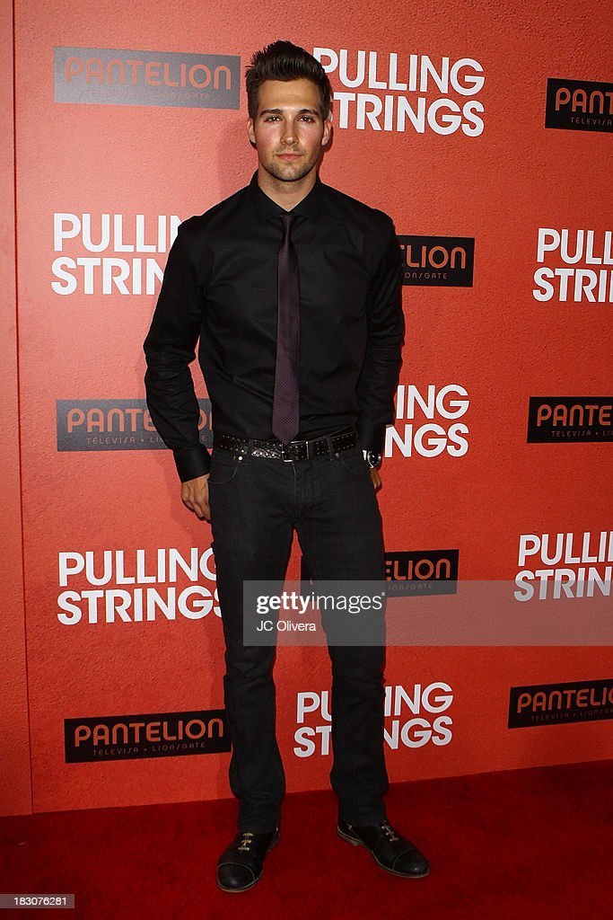Actor <a gi-track='captionPersonalityLinkClicked' href=/galleries/search?phrase=James+Maslow&family=editorial&specificpeople=6522849 ng-click='$event.stopPropagation()'>James Maslow</a> attends Los Angeles Premiere of 'Pulling Strings' at Regal Cinemas L.A. Live on October 3, 2013 in Los Angeles, California.