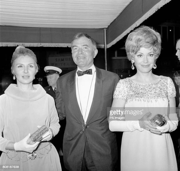 Actor James Mason centre escorting Hollywood actresses Joanne Woodward left wife of Paul Newman and Barbara Rush at the premiere of his new film...