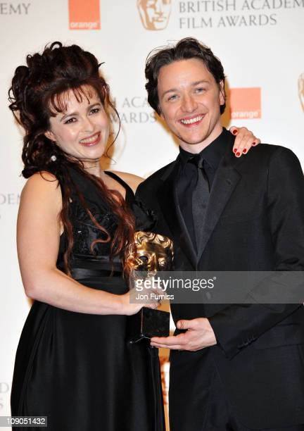 Actor James McAvoy poses with Actress Helena Bonham Carte winner of Supporting Actress for the film 'The King's Speech' during the 2011 Orange...