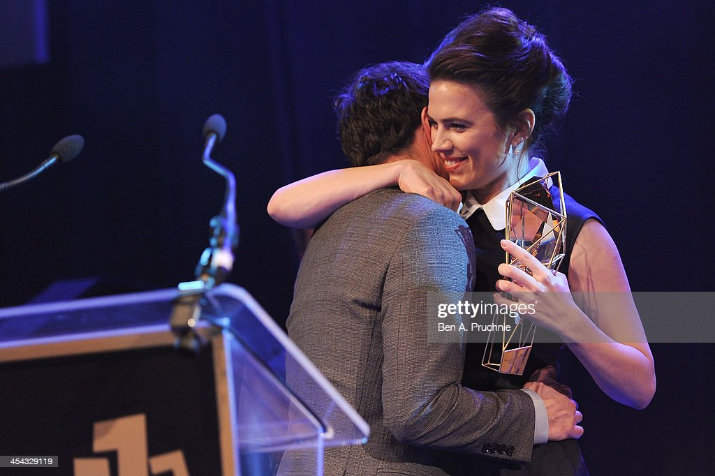 Actor James McAvoy receives the award for Best Actor from actress Hayley Atwell as he attends the ceremony for the Moet British Independent Film Awards at Old Billingsgate Market on December 8, 2013 in London, England.
