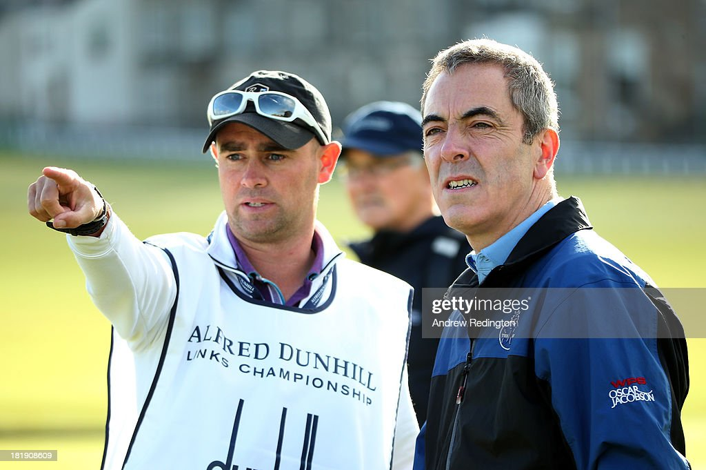 Actor James Nesbitt with his caddy on the second tee during the first round of the Alfred Dunhill Links Championship on The Old Course, at St Andrews on September 26, 2013 in St Andrews, Scotland.