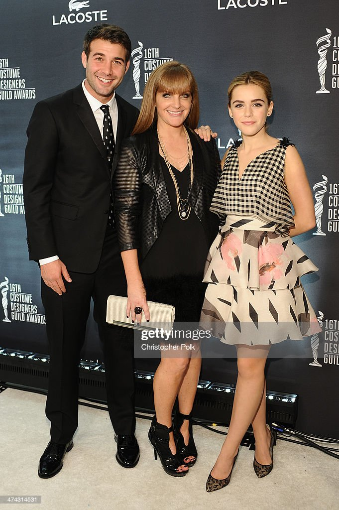 Actor James Wolk, Costume Designer's Guild Awards Executive Producer JL Pomeroy and actress Kiernan Shipka attend the 16th Costume Designers Guild Awards with presenting sponsor Lacoste at The Beverly Hilton Hotel on February 22, 2014 in Beverly Hills, California.