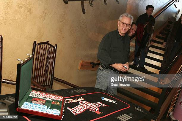Actor James Woods visits the Michelob Amber Bock World Poker Tour display at the Gibson Gift Lounge during the 2005 Sundance Film Festival on January...