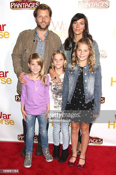 Actor Jamie Bamber and family attend the 'War Horse' Los Angeles opening night held at the Pantages Theatre on October 8 2013 in Hollywood California