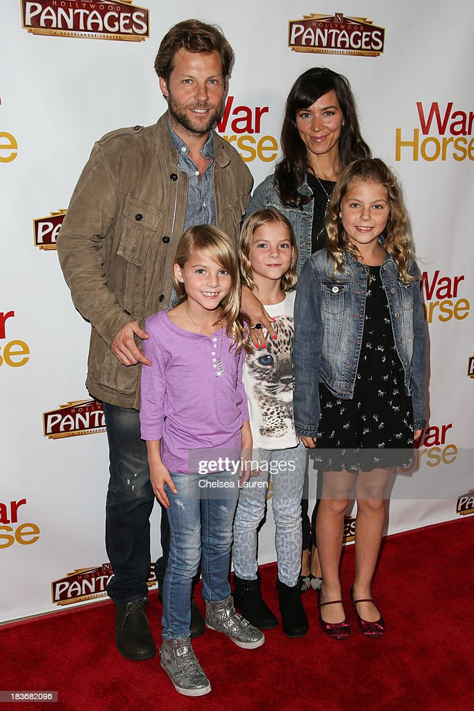 Actor <a gi-track='captionPersonalityLinkClicked' href=/galleries/search?phrase=Jamie+Bamber&family=editorial&specificpeople=4238397 ng-click='$event.stopPropagation()'>Jamie Bamber</a> (L) attends the 'War Horse' red carpet opening night at the Pantages Theatre on October 8, 2013 in Hollywood, California.