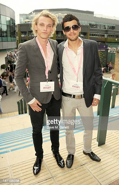 Actor Jamie Campbell Bower and Tristan Marmont attend the evian 'Live young' VIP Suite at Wimbledon on June 25 2012 in London England