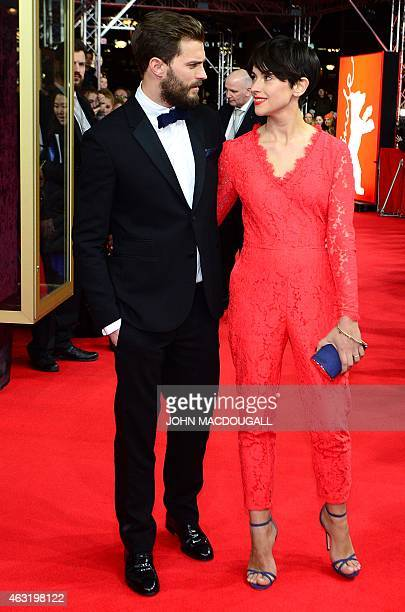 US actor Jamie Dornan and his wife Amelia Warner pose for photographers on the red carpet as they arrive for the screening of Fifty 'Shades of Grey'...