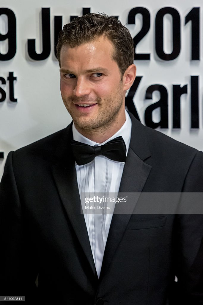 Actor <a gi-track='captionPersonalityLinkClicked' href=/galleries/search?phrase=Jamie+Dornan&family=editorial&specificpeople=243194 ng-click='$event.stopPropagation()'>Jamie Dornan</a> poses for photographers at the opening ceremony of the 51st Karlovy Vary International Film Festival (KVIFF) on July 1, 2016 in Karlovy Vary, Czech Republic.