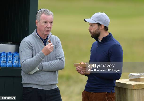 Actor Jamie Dornan stops for a hotdog on the fifth hole during day four of the Alfred Dunhill Links Championship atSt Andrews Old Course Fife