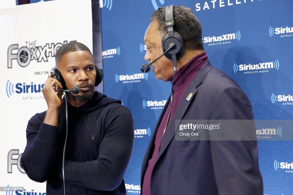 Actor Jamie Fox (L) hosts SiriusXM's The Foxxhole show with special guest Jesse Jackson (R) at Super Bowl XLVIII Radio Row on January 31, 2014 in New York City.