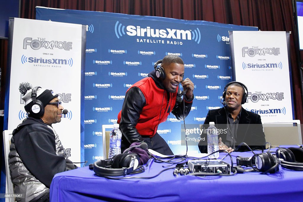 Actor Jamie Fox (C) hosts SiriusXM's The Foxxhole show with special guests Spike Lee (L) and Chris Tucker (R) at Super Bowl XLVIII Radio Row on January 31, 2014 in New York City.