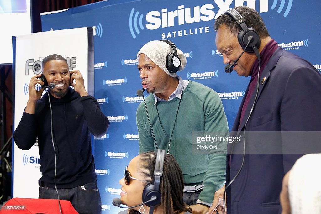 Actor Jamie Fox (L) hosts SiriusXM's The Foxxhole show with special guests Marlon Wayans (C) and Jesse Jackson (R) at Super Bowl XLVIII Radio Row on January 31, 2014 in New York City.