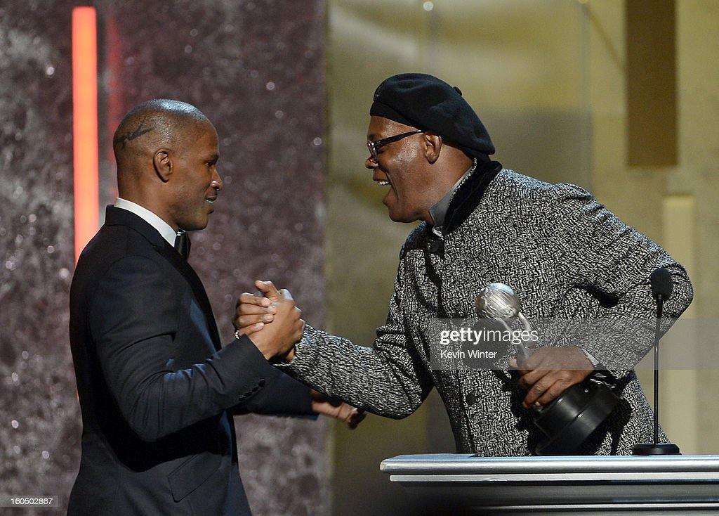 Actor Jamie Foxx (L) accepts Entertainer of the Year award from Samuel L. Jackson (R) onstage during the 44th NAACP Image Awards at The Shrine Auditorium on February 1, 2013 in Los Angeles, California.