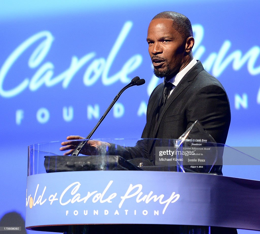 Actor Jamie Foxx accepts the Harold and Carol Pump Foundation Lifetime Achievement Award at 13th Annual Harold And Carole Pump Foundation Gala Honoring Jamie Foxx, Shaquille O'Neal, And Joe Torre at The Beverly Hilton Hotel on August 9, 2013 in Beverly Hills, California.