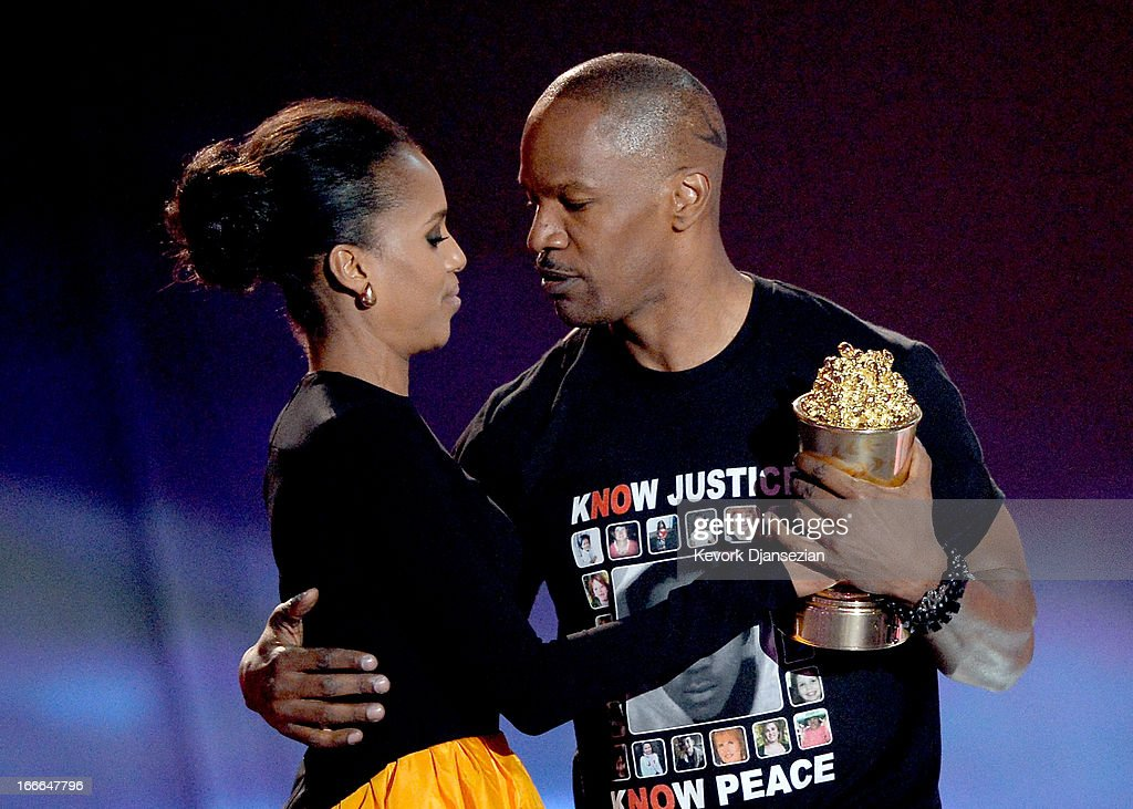 Actor <a gi-track='captionPersonalityLinkClicked' href=/galleries/search?phrase=Jamie+Foxx&family=editorial&specificpeople=201715 ng-click='$event.stopPropagation()'>Jamie Foxx</a> (R) accepts the MTV Generation Award from actress <a gi-track='captionPersonalityLinkClicked' href=/galleries/search?phrase=Kerry+Washington&family=editorial&specificpeople=201534 ng-click='$event.stopPropagation()'>Kerry Washington</a> onstage during the 2013 MTV Movie Awards at Sony Pictures Studios on April 14, 2013 in Culver City, California.