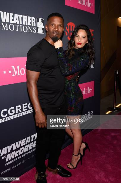 Actor Jamie Foxx and Actress Olivia Munn arrive on TMobile's magenta carpet duirng the Showtime WME IME and Mayweather Promotions VIP PreFight Party...