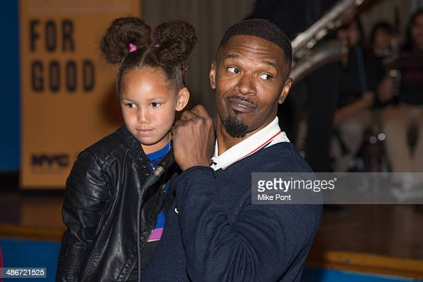 Actor Jamie Foxx and daughter Annalise Bishop Foxx attend 'The Amazing SpiderMan 2' Be Amazing Day Volunteer Day at IS 145 Joseph Pulitzer on April...