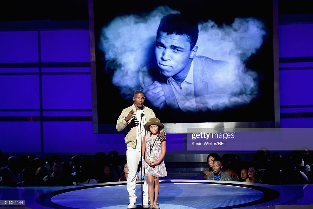 Actor <a gi-track='captionPersonalityLinkClicked' href=/galleries/search?phrase=Jamie+Foxx&family=editorial&specificpeople=201715 ng-click='$event.stopPropagation()'>Jamie Foxx</a> (L) and daughter <a gi-track='captionPersonalityLinkClicked' href=/galleries/search?phrase=Annalise+Bishop&family=editorial&specificpeople=10846979 ng-click='$event.stopPropagation()'>Annalise Bishop</a> speak onstage during the 2016 BET Awards at the Microsoft Theater on June 26, 2016 in Los Angeles, California.
