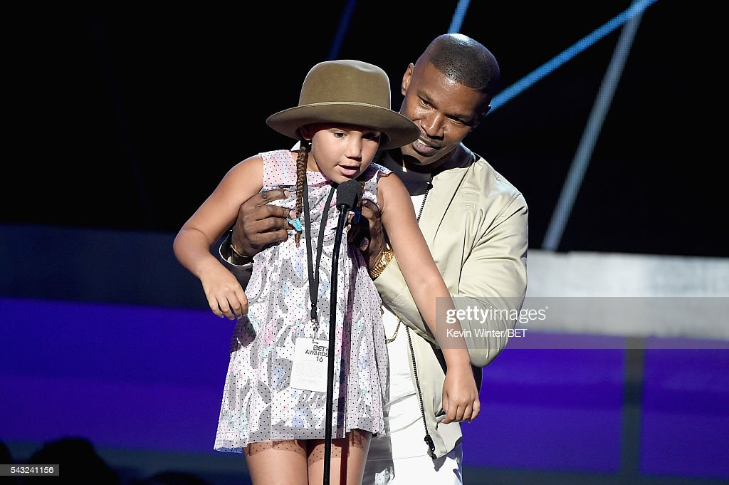 Actor <a gi-track='captionPersonalityLinkClicked' href=/galleries/search?phrase=Jamie+Foxx&family=editorial&specificpeople=201715 ng-click='$event.stopPropagation()'>Jamie Foxx</a> (R) and daughter <a gi-track='captionPersonalityLinkClicked' href=/galleries/search?phrase=Annalise+Bishop&family=editorial&specificpeople=10846979 ng-click='$event.stopPropagation()'>Annalise Bishop</a> speak onstage during the 2016 BET Awards at the Microsoft Theater on June 26, 2016 in Los Angeles, California.