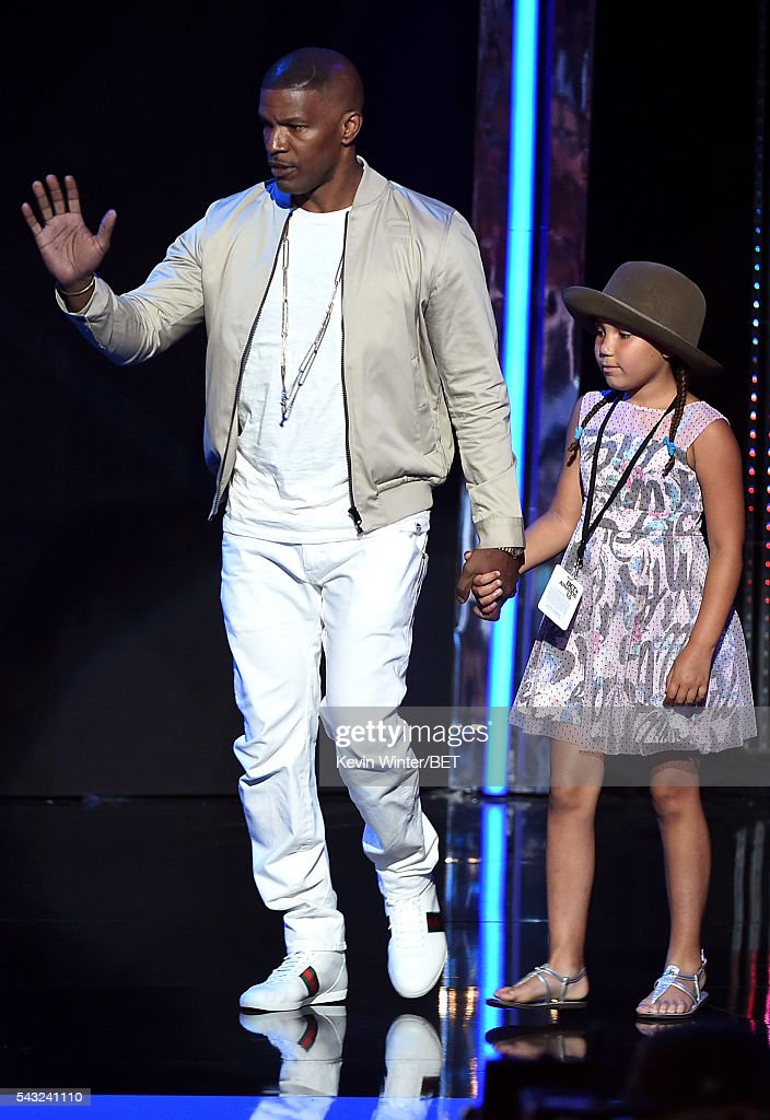 Actor <a gi-track='captionPersonalityLinkClicked' href=/galleries/search?phrase=Jamie+Foxx&family=editorial&specificpeople=201715 ng-click='$event.stopPropagation()'>Jamie Foxx</a> (L) and daughter <a gi-track='captionPersonalityLinkClicked' href=/galleries/search?phrase=Annalise+Bishop&family=editorial&specificpeople=10846979 ng-click='$event.stopPropagation()'>Annalise Bishop</a> walk onstage during the 2016 BET Awards at the Microsoft Theater on June 26, 2016 in Los Angeles, California.