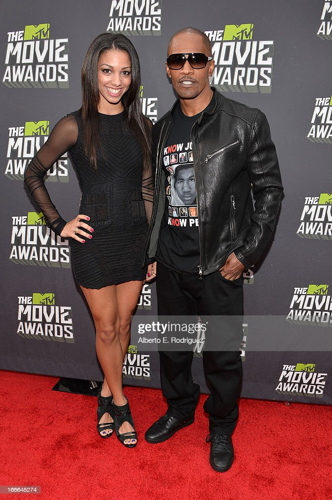 Actor Jamie Foxx (R) and daughter Corinne Bishop arrive at the 2013 MTV Movie Awards at Sony Pictures Studios on April 14, 2013 in Culver City, California.