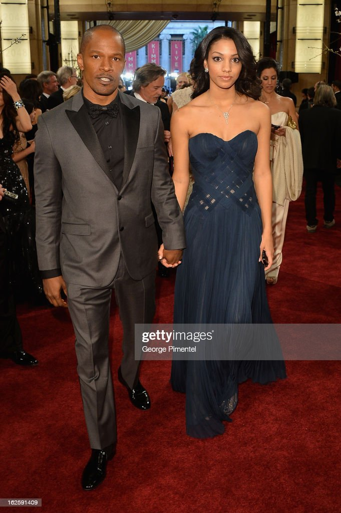 Actor <a gi-track='captionPersonalityLinkClicked' href=/galleries/search?phrase=Jamie+Foxx&family=editorial&specificpeople=201715 ng-click='$event.stopPropagation()'>Jamie Foxx</a> (L) and daughter Corinne Bishop arrives at the Oscars at Hollywood & Highland Center on February 24, 2013 in Hollywood, California.